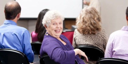 Real People:  Senior Adult Business Woman Presentation Small Gro