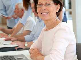 Senior woman attending business training
