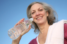 stock-photo-8294031-smiling-woman-drinking-water
