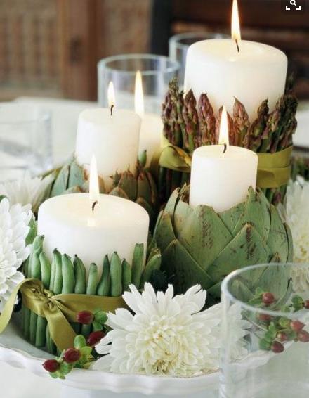 Candele bianche e vegetali dalla cucina