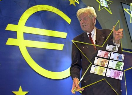 Dutch Wim Duisenberg, President of the European Central Bank, stands in front of a large Euro sign (L) as he prepares to display the new Euro bills during a press conference at the bank in Frankfurt, 30 August 2001.  ANSA /BORIS ROESSLER