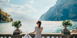 Young beautiful woman relaxing on picturesque Garda Lake